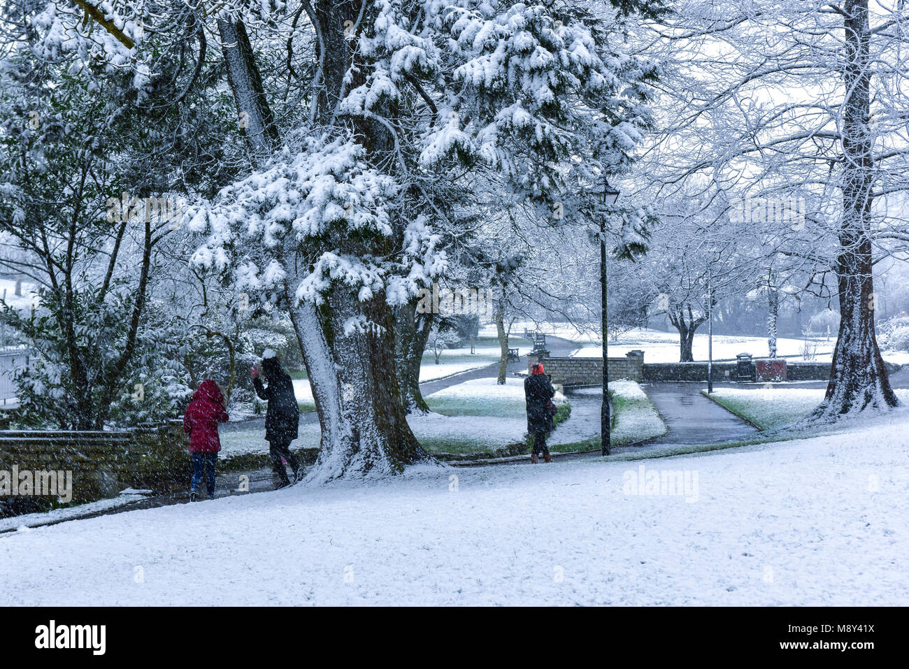 People enjoying the heavy snow fall on Trenance Gardens in Newquay Cornwall. - Stock Image