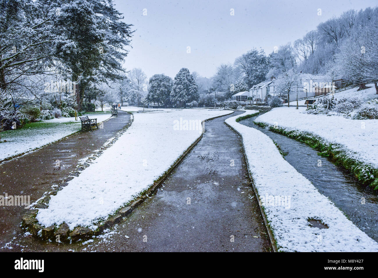 Snowing heavily in Trenance Gardens in Newquay Cornwall. - Stock Image
