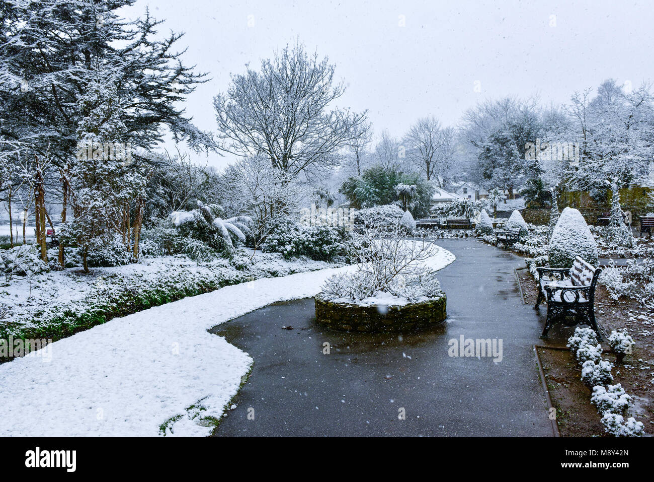 Snow falling over the historic trenance gardens in Newquay Cornwall. - Stock Image