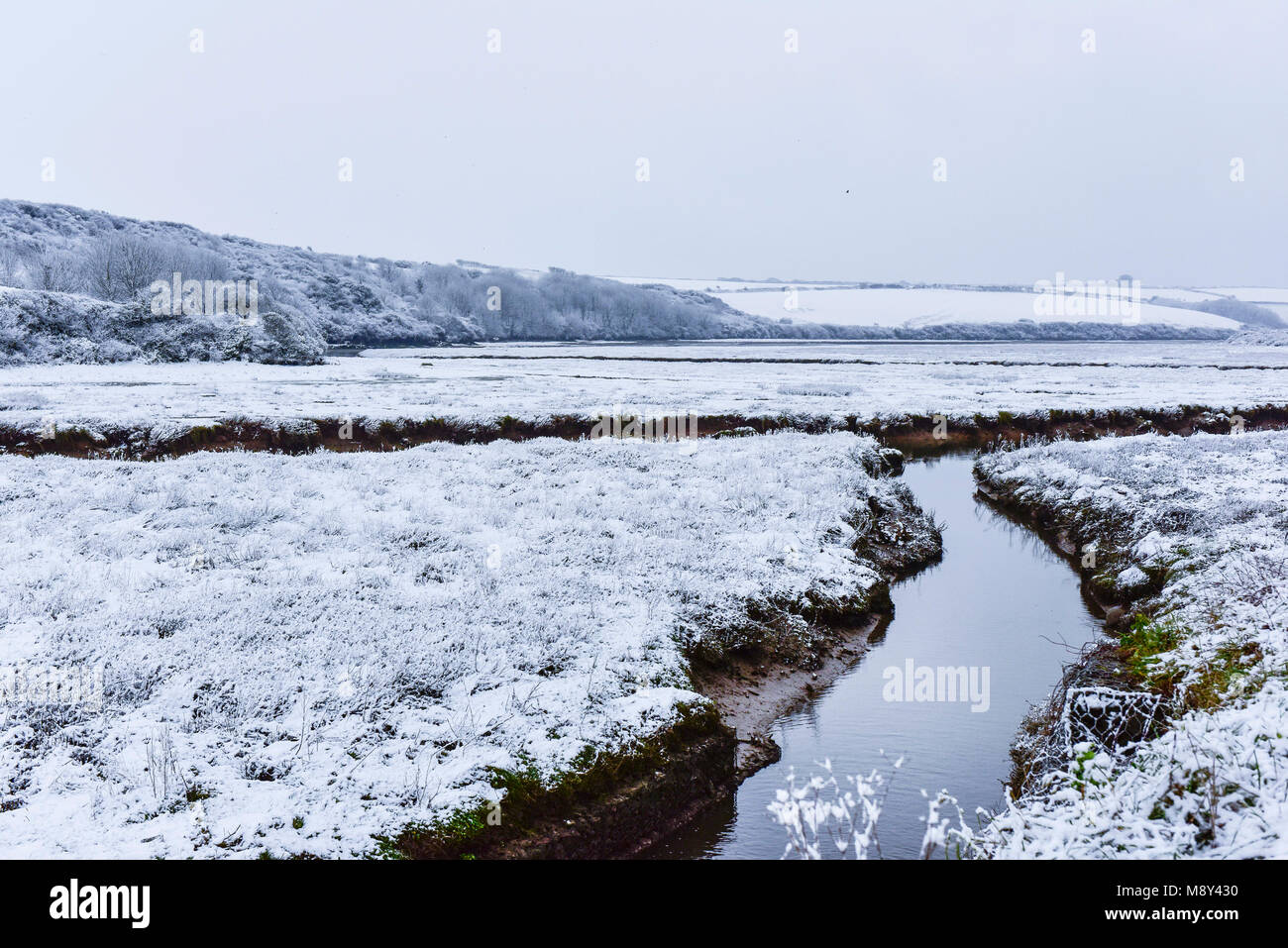 Snow covered Gannel Estuary in Newquay Cornwall. - Stock Image
