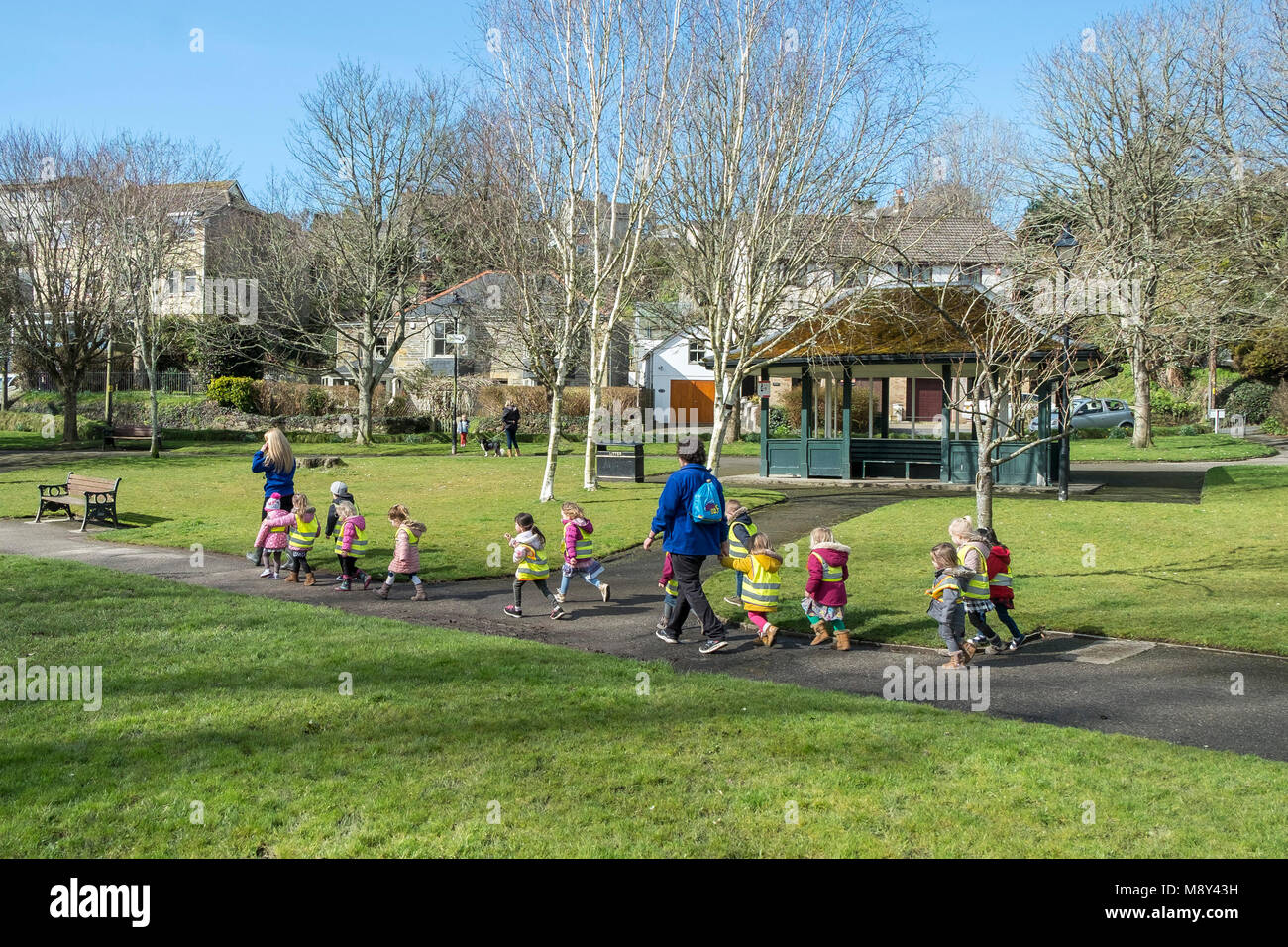 Children from a nursery and their teachers walking though Trenance Gardens in Newquay Cornwall. - Stock Image