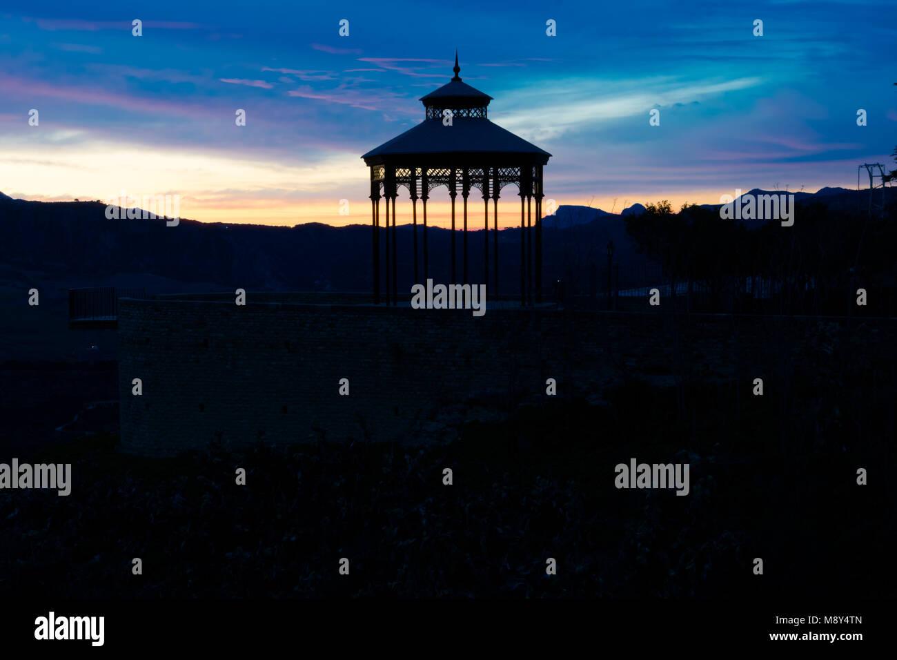 Sunset view of the Ronda Viewpoint (Mirador de Ronda) and the old pergola. Ronda, Spain Stock Photo