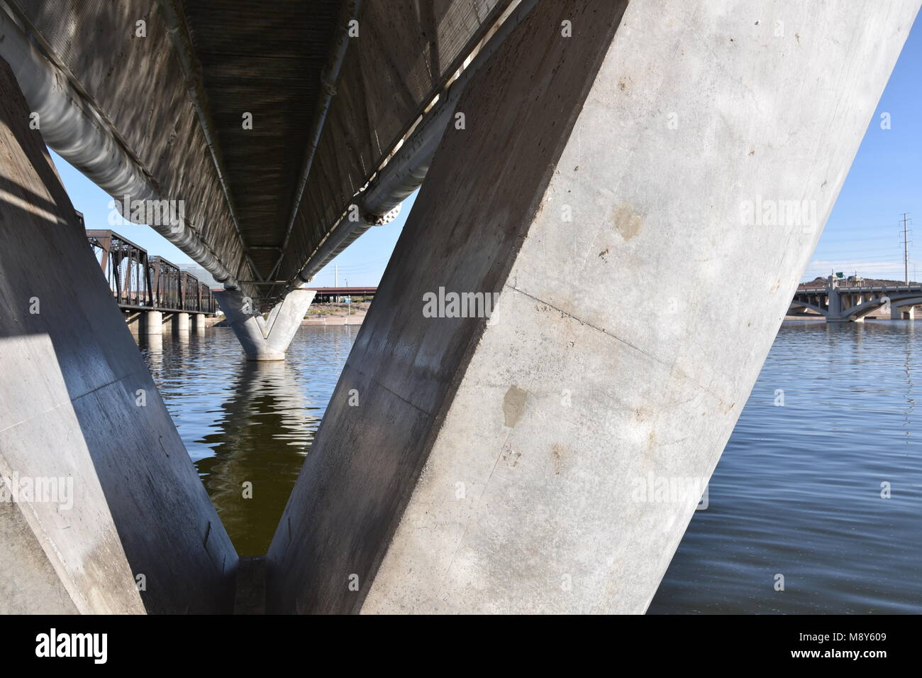 Light rail bridge across the Salt River Tempe Town Lake long view with angles and triangles - Stock Image