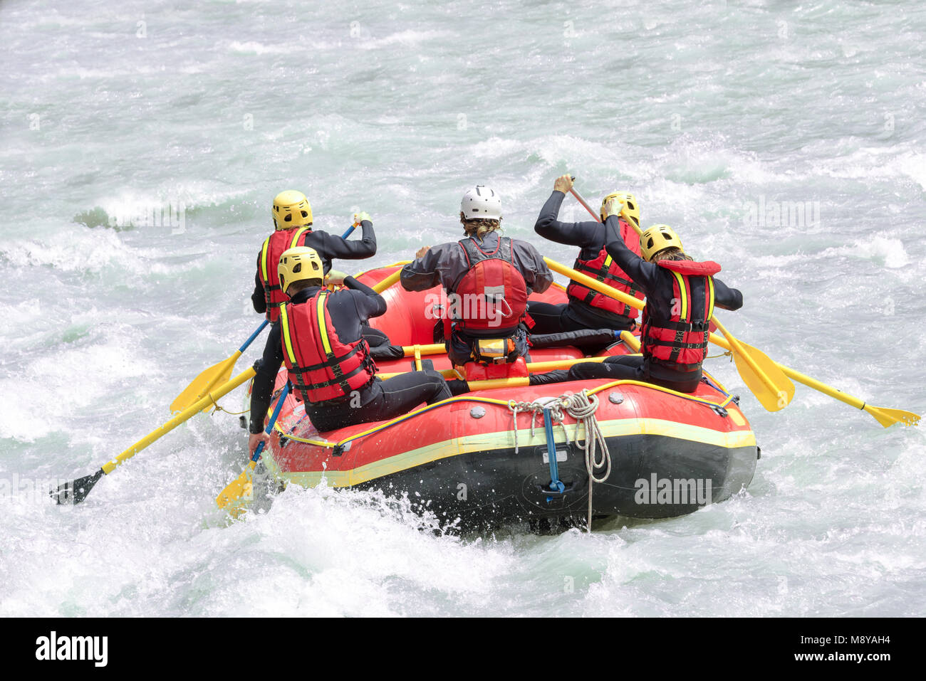 Group of people rafting on white water, active vacations, team concept - Stock Image