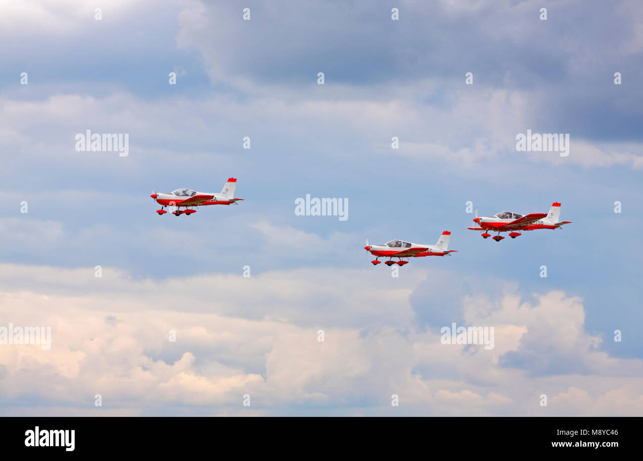 The Zlin 242L with two Zlin 143LSi flying over cloudy sky during International Air Show at the 90th Jubilee of The - Stock Image