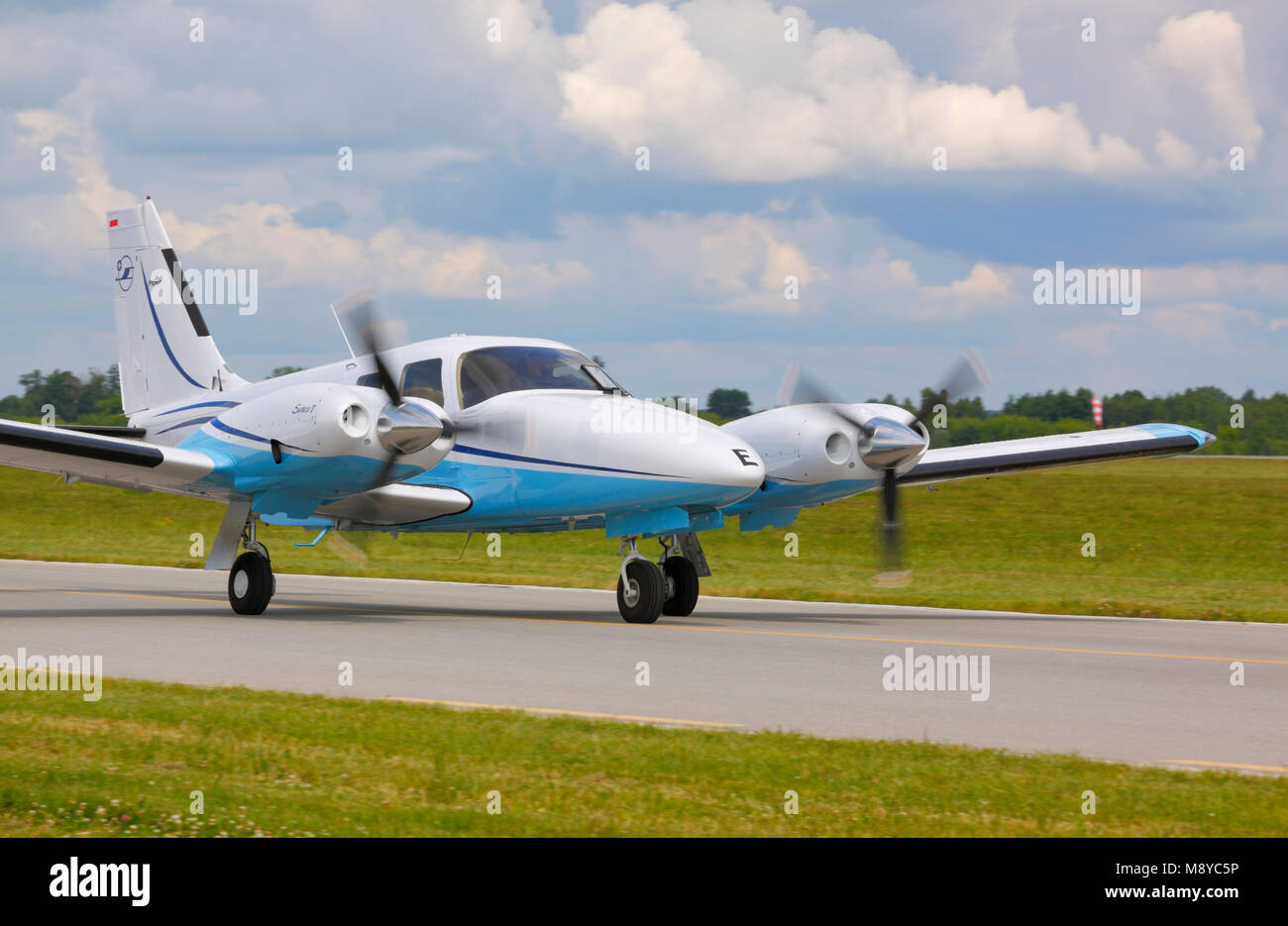 The Piper PA-34 Seneca V on runway during International Air Show at the 90th Jubilee of The Polish Air Force Academy - Stock Image