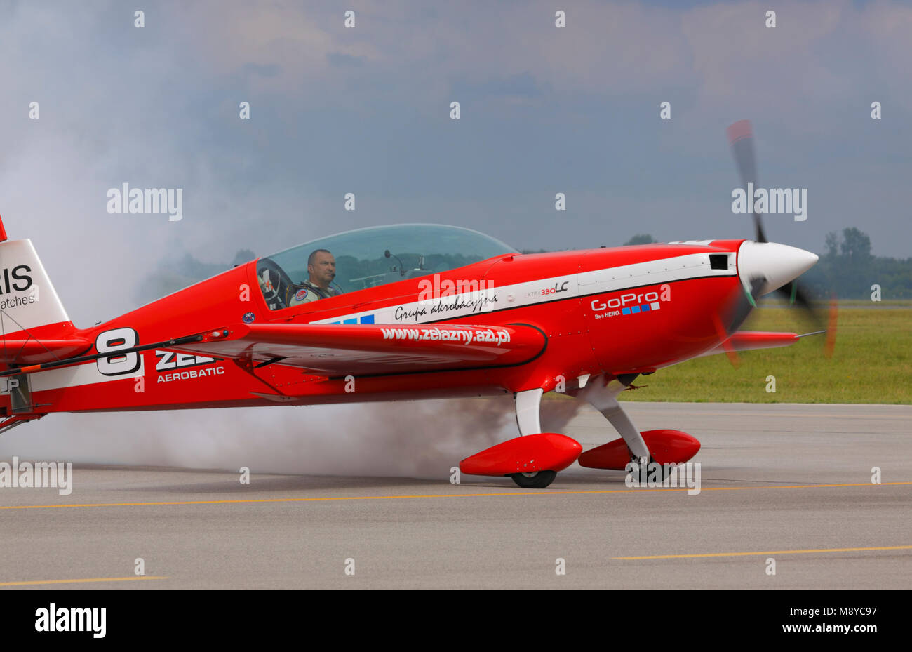 The Extra 330 LC of the Zelazny Aerobatic Team on runway during International Air Show at the 90th Jubilee of The - Stock Image
