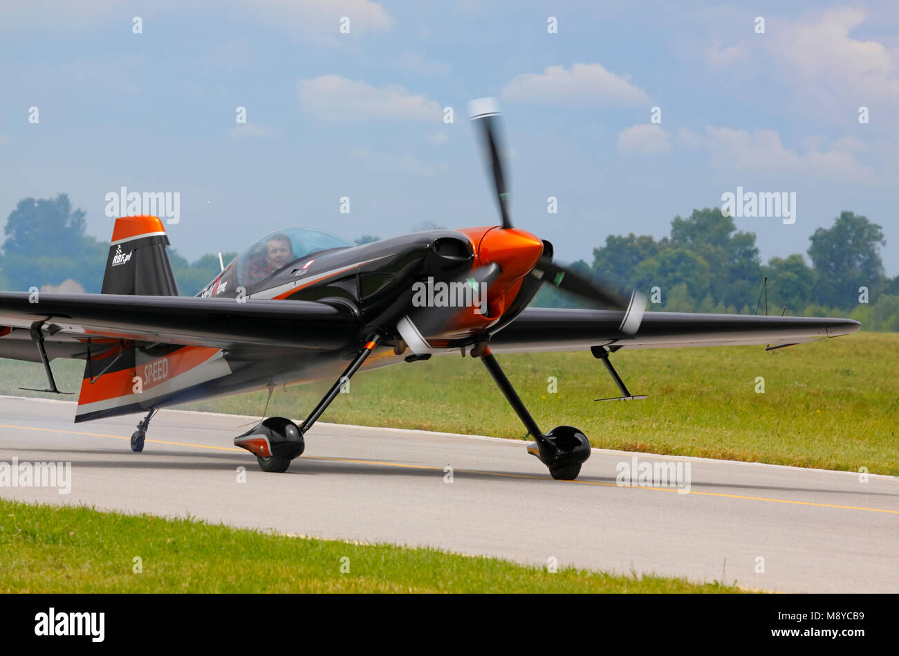 The XtremeAir Sbach 300 on runway during International Air Show at the 90th Jubilee of The Polish Air Force Academy - Stock Image