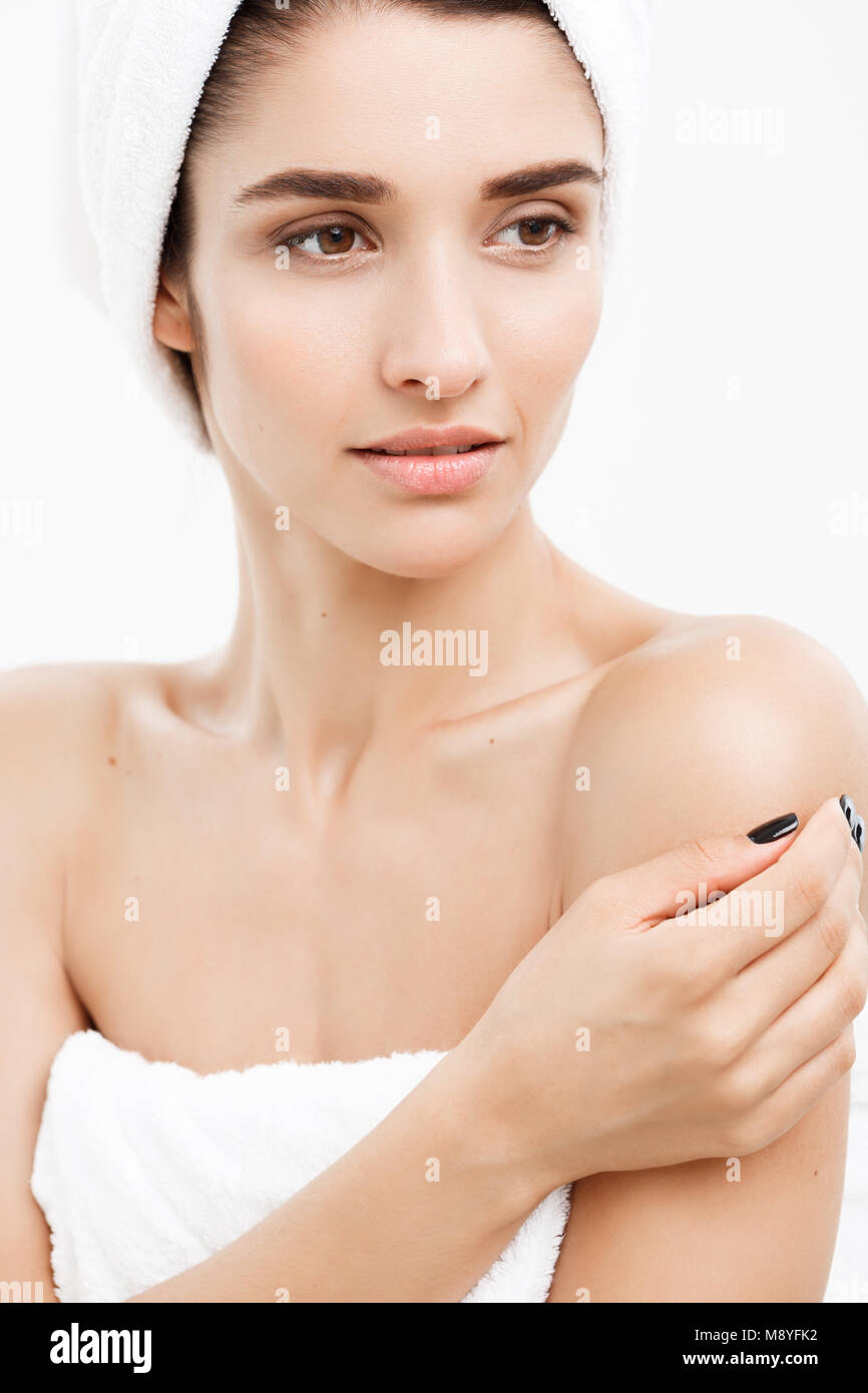 Beauty and Skin care concept - Close up Beautiful Young Woman touching her skin - Stock Image