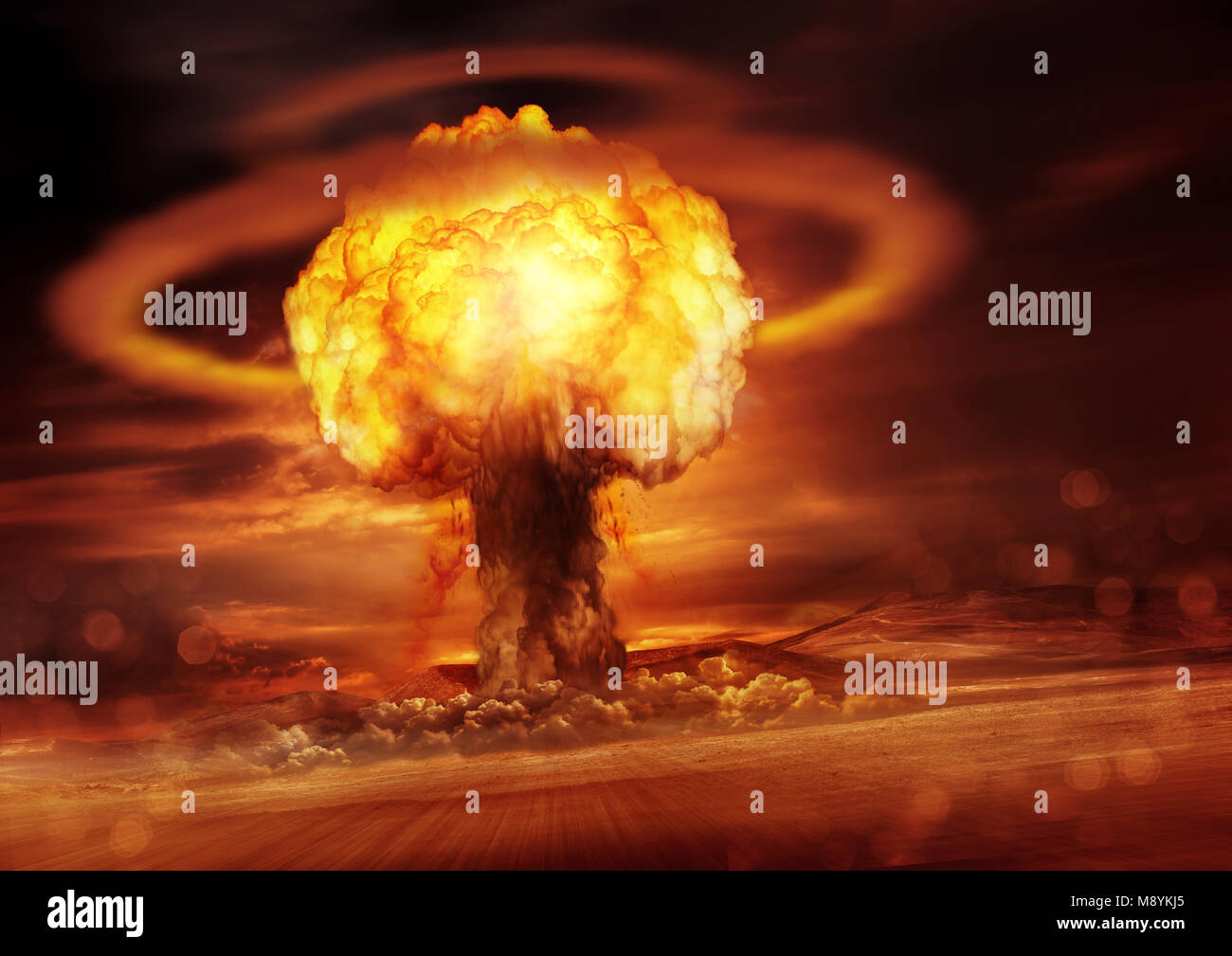 A nuclear bomb explosion causing shock waves. Mixed media illustration. - Stock Image
