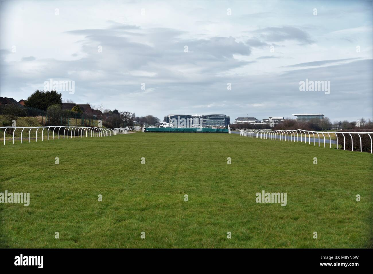 10th March 2018. Aintree Racecourse, Liverpool, UK. View of the course and grandstands  from the course itself. Stock Photo