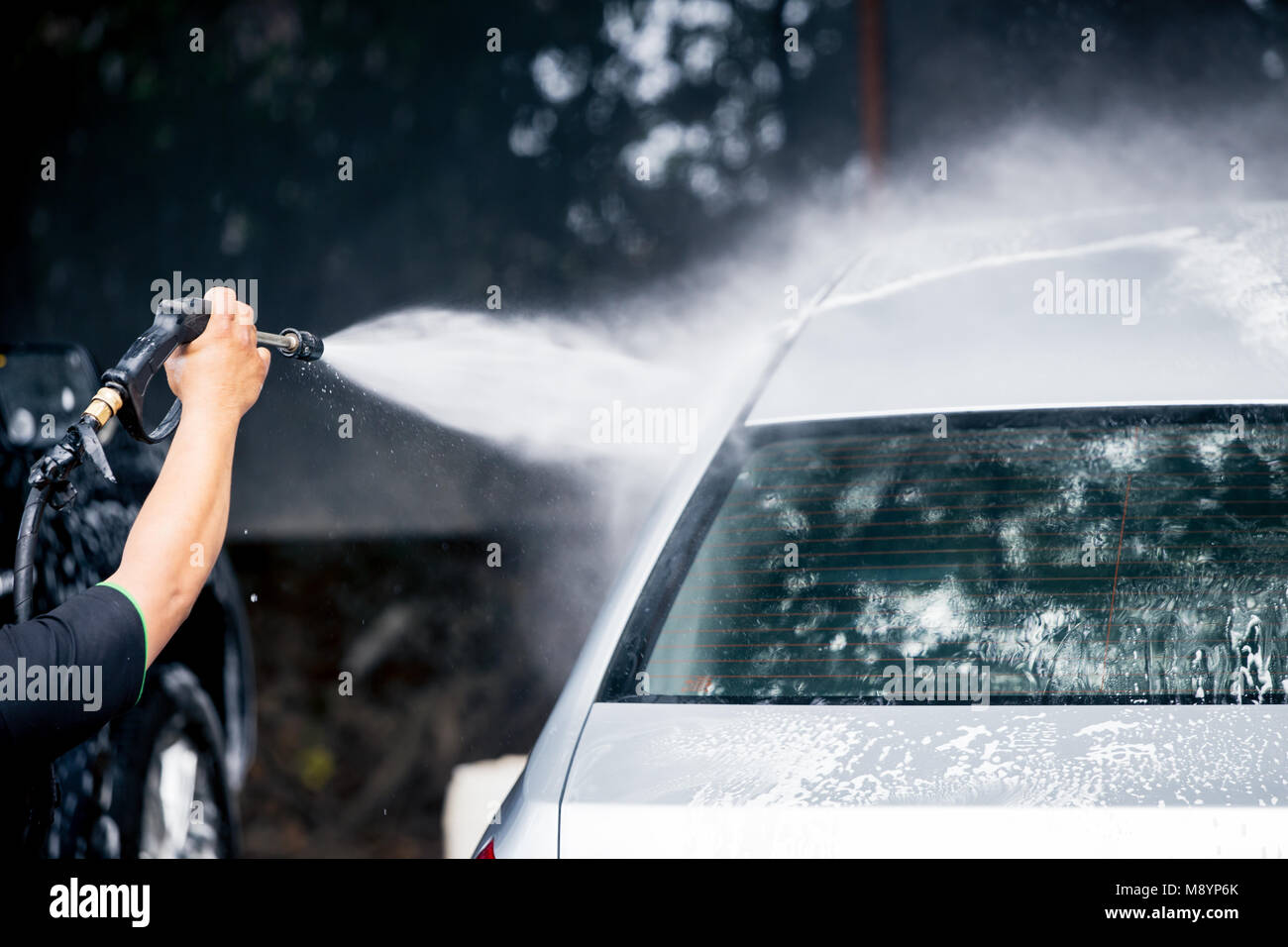 Cleaning car care with High pressure water cleaner - Stock Image