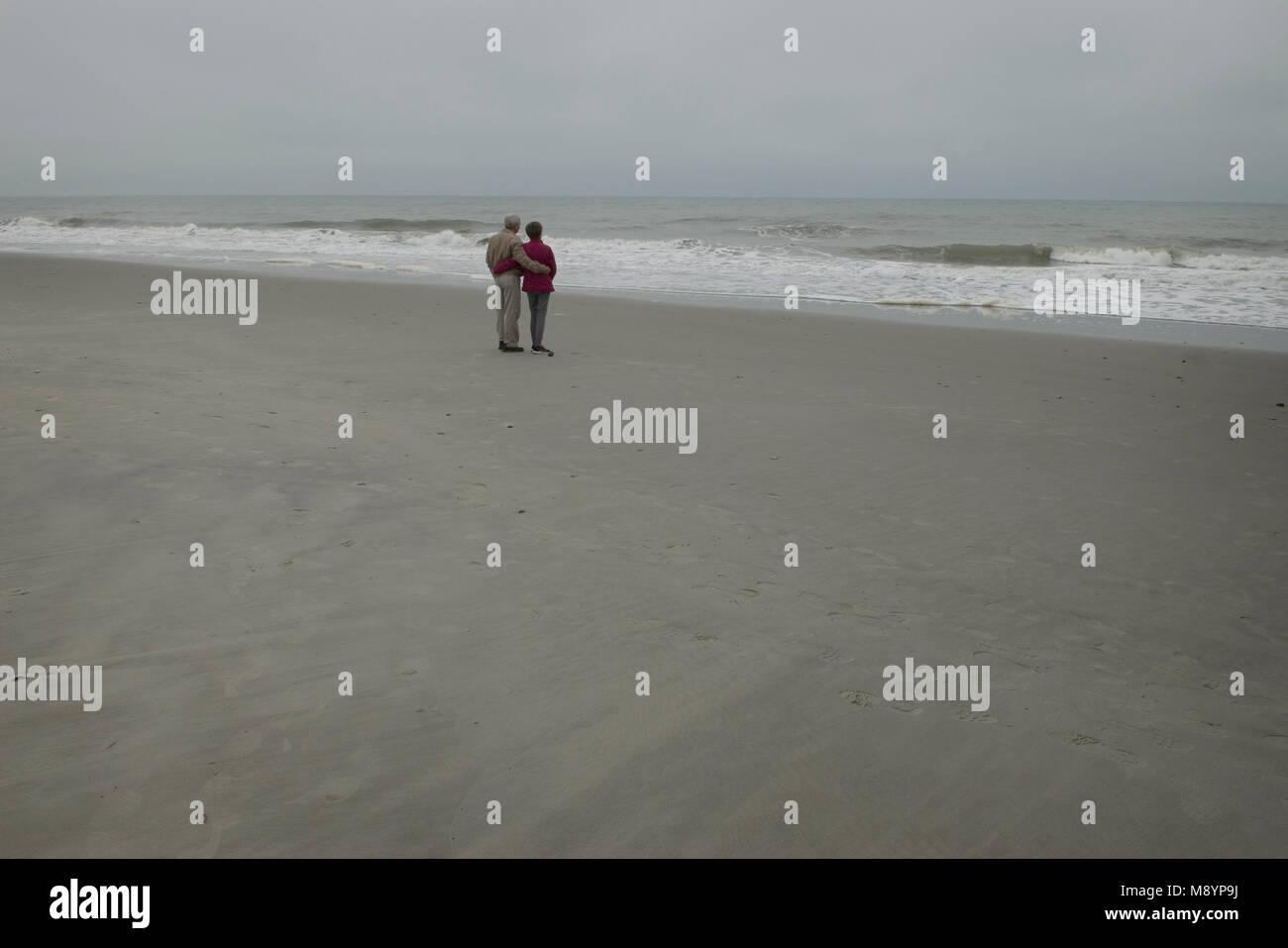 Senior couple views ocean at Myrtle Beach, South Carolina, USA. - Stock Image