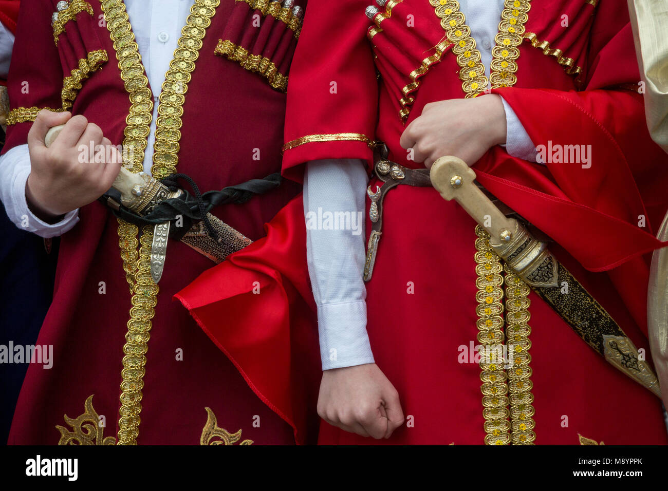 Dagestan boys attend a ceremony to admit children into the Pioneer movement, in Moscow's Red Square, Russia - Stock Image