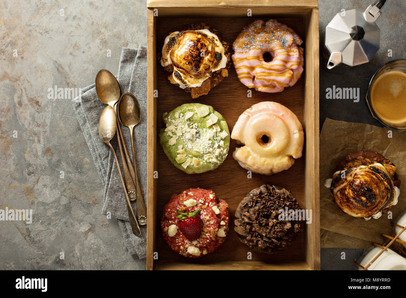 Variety of donuts in a wooden box - Stock Image