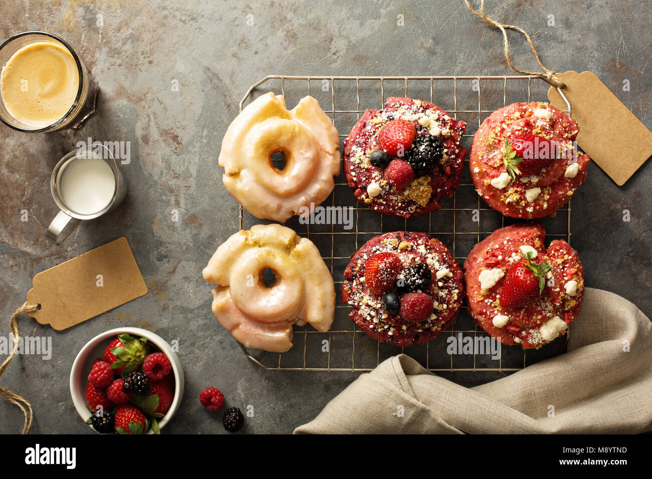 Variety of donuts on a cooling rack - Stock Image