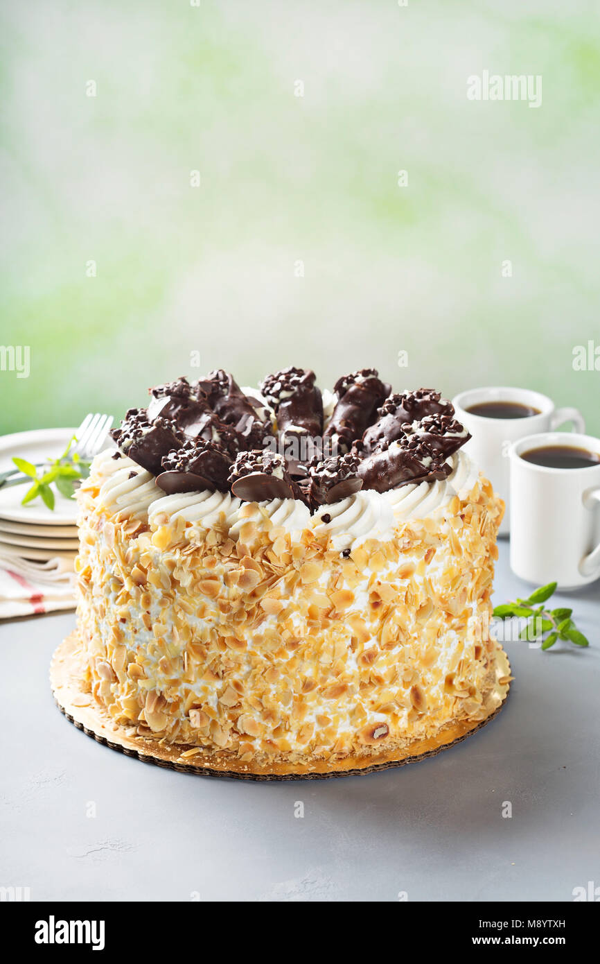 Italian cake with chocolate cannoli on top - Stock Image