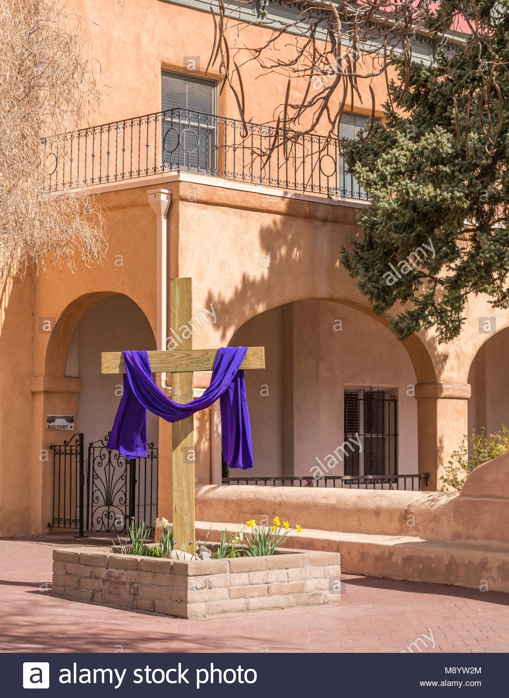 Easter cross draped in purple cloth at San Felipe de Neri Catholic Church in Albuquerque Old Town, New Mexico, USA. - Stock Image