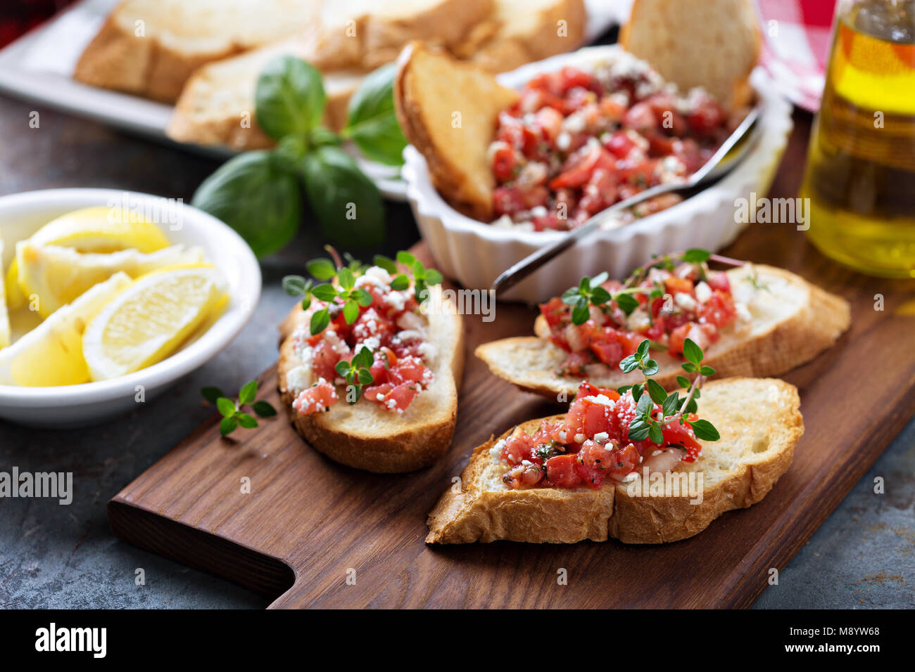 Roasted tomatoes bruschetta with thyme - Stock Image