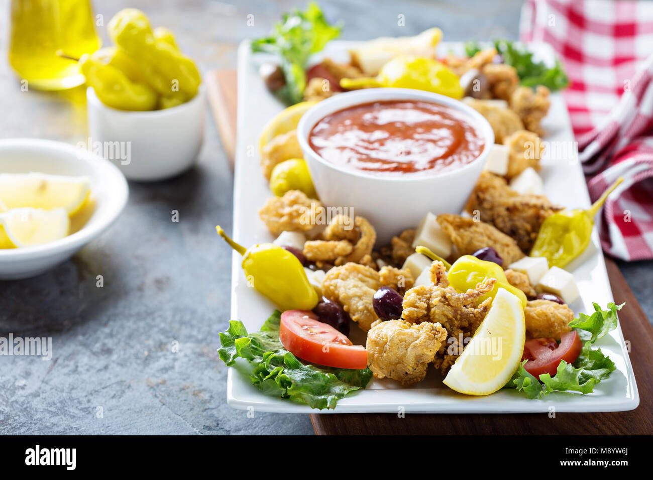 Fried calamari with marinara sauce - Stock Image