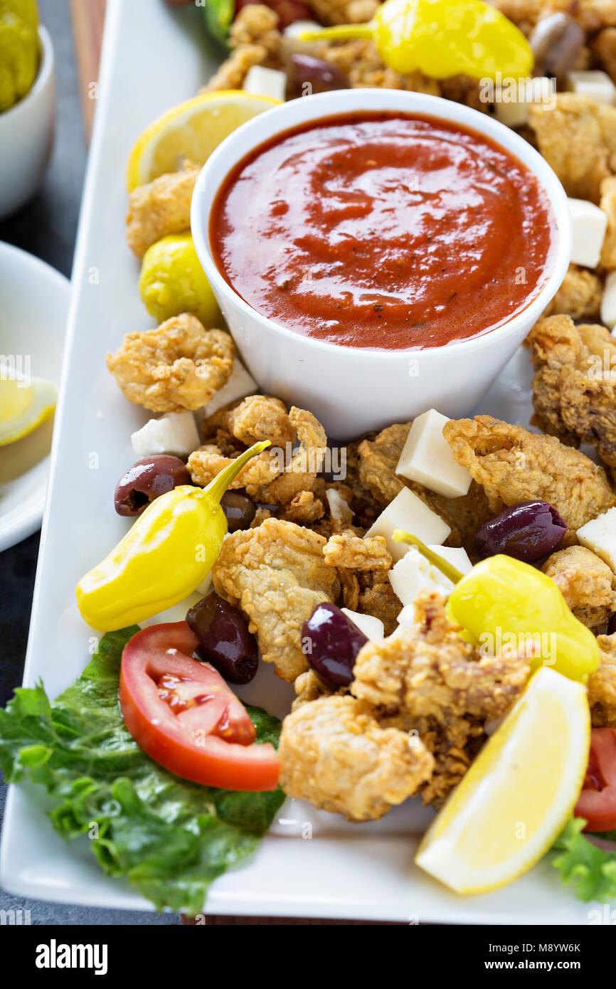Fried calamari with marinara sauce - Stock Image