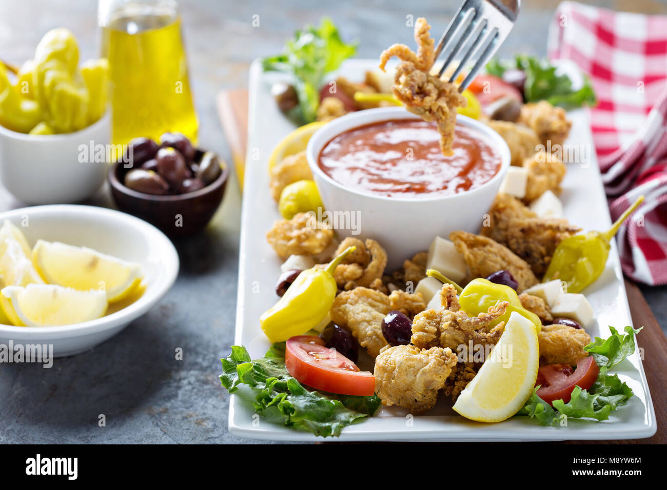 Fried calamari with marinara sauce Stock Photo