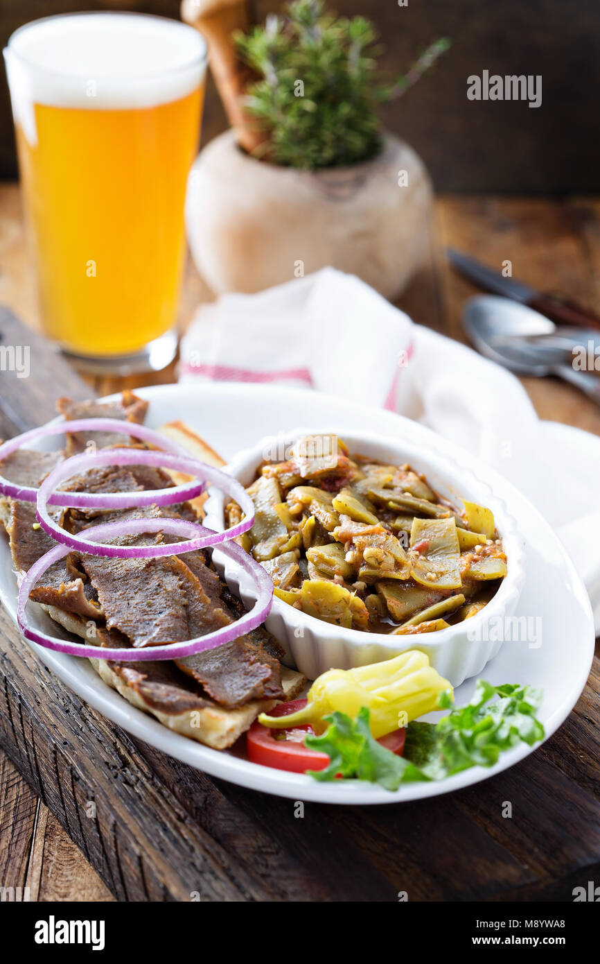 Gyro plate with meat on a pita - Stock Image