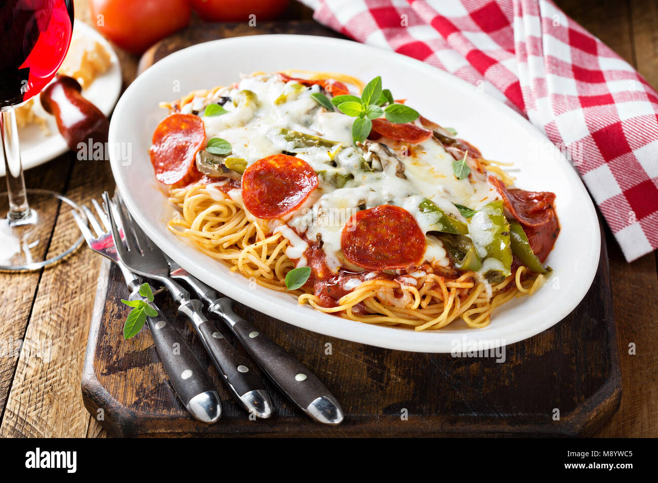 Baked pasta with cheese and pepperoni - Stock Image