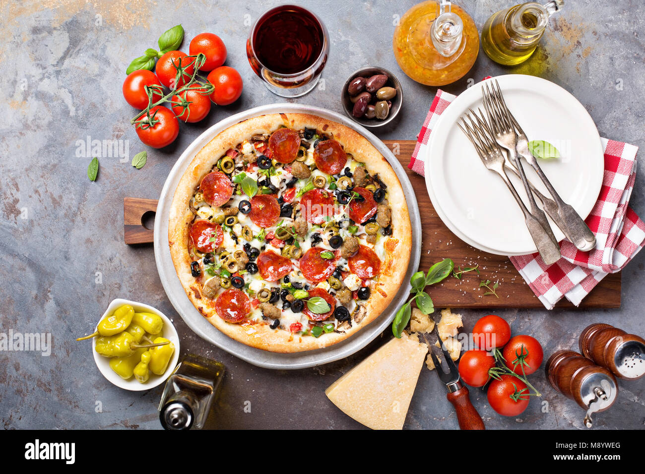 Pepperoni pizza with olives - Stock Image
