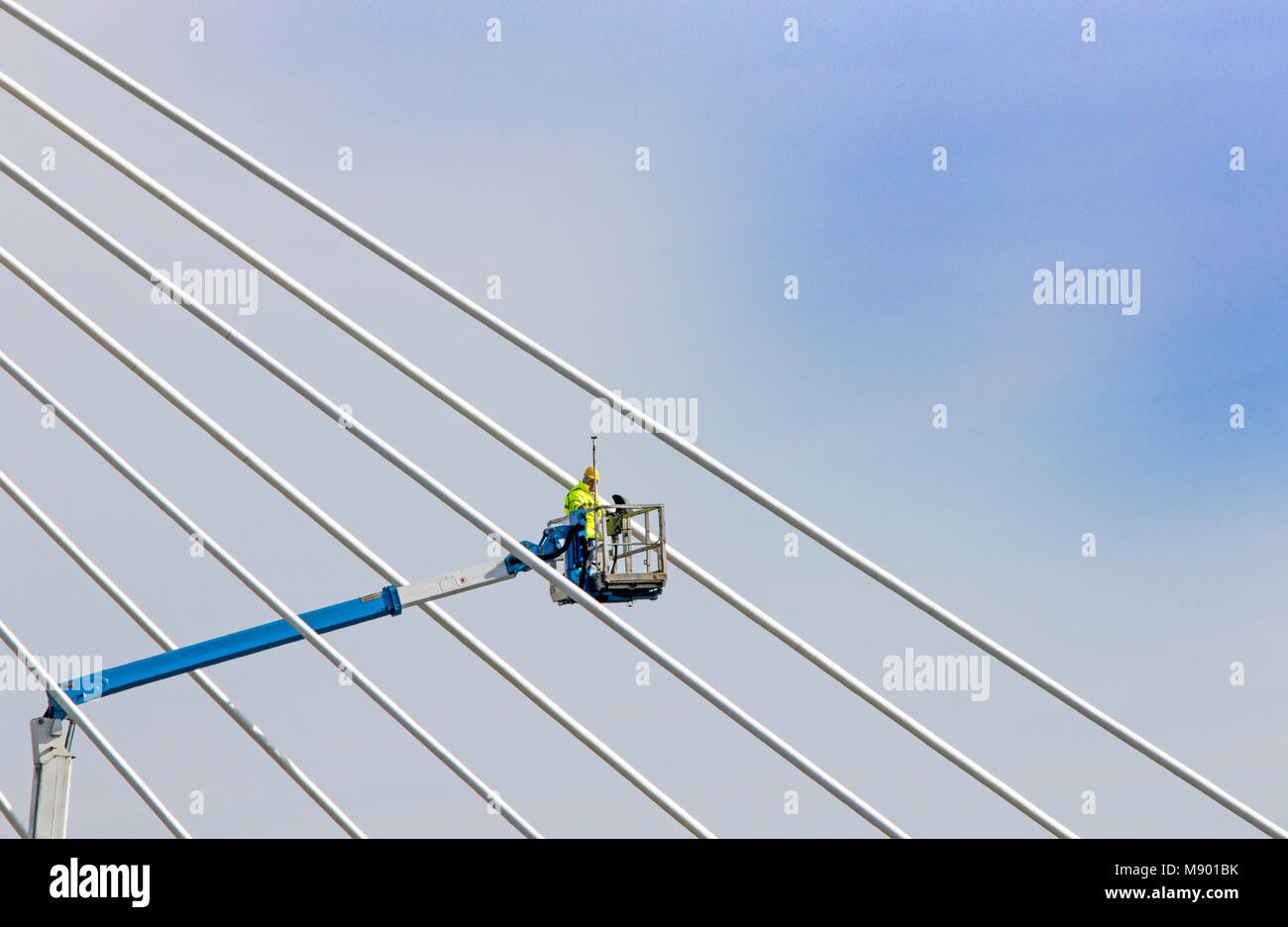 mobile elevated work platform telescopic construction worker working at height suspension bridge southport merseyside - Stock Image