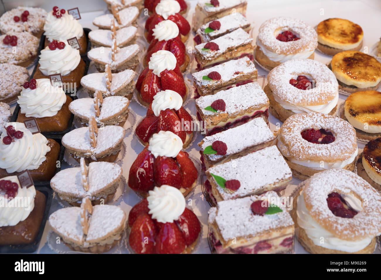 Tasty pastries in window of French patisserie shop, Arras, Pas-de-Calais, Hauts-de-France region, France, Europe - Stock Image