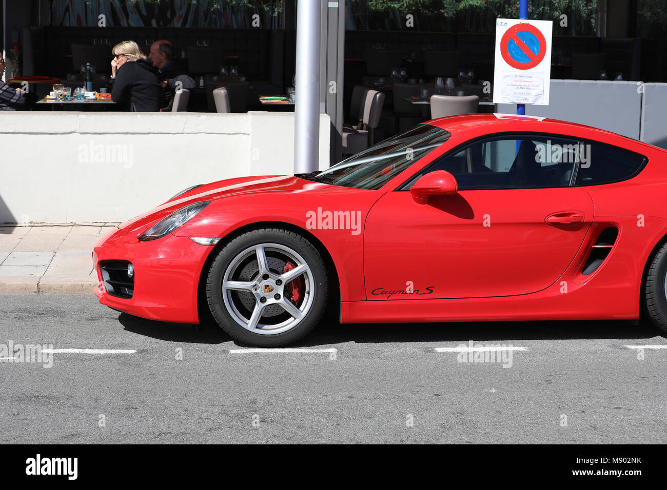 Menton, France - March 19, 2018: Luxury Red Porsche 718 Cayman S Badly Parked Car In The Street Of Menton On The - Stock Image