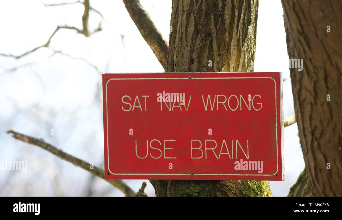 A notice advising motorists to use their  brains and not their satnav. - Stock Image