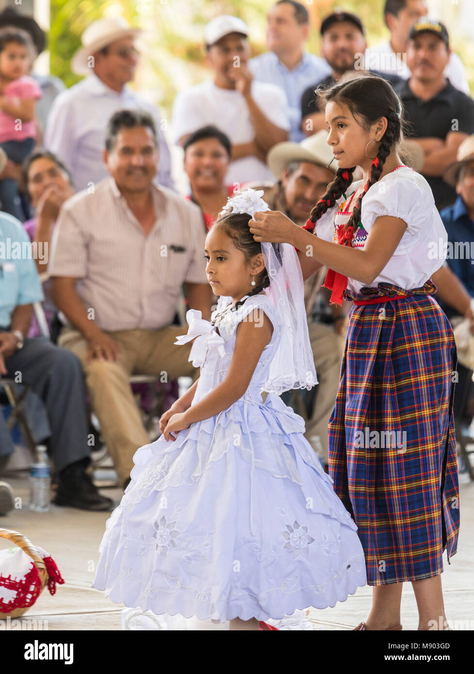 San Juan Teitipac, Oaxaca, Mexico - A child bride gets ready for a pretend wedding during the town's Linguistic - Stock Image
