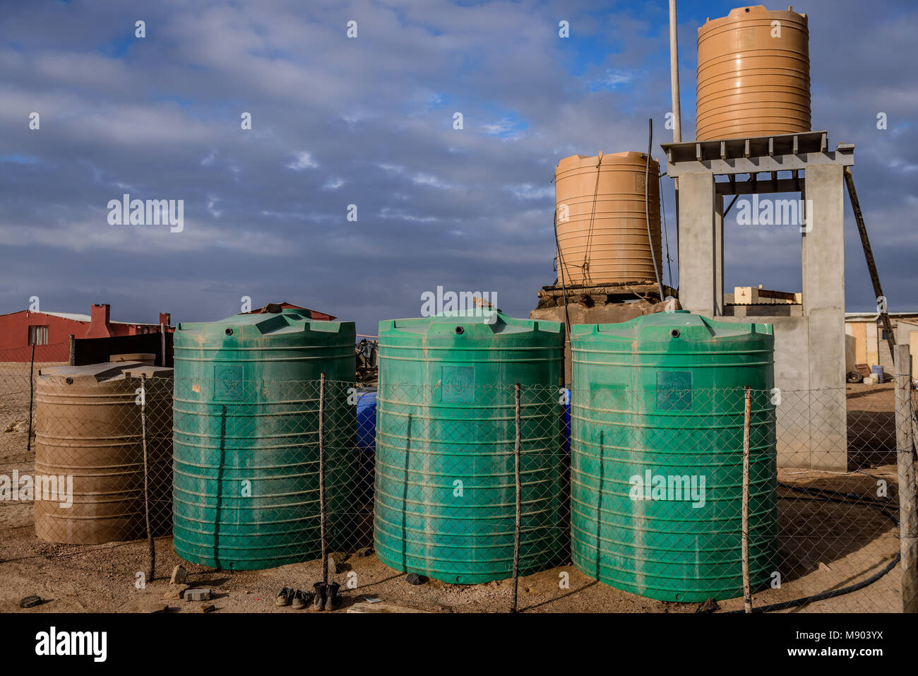 Water storage tanks form part of a individually designed desalinatiion plant on Namibia's Skeleton Coast - Stock Image