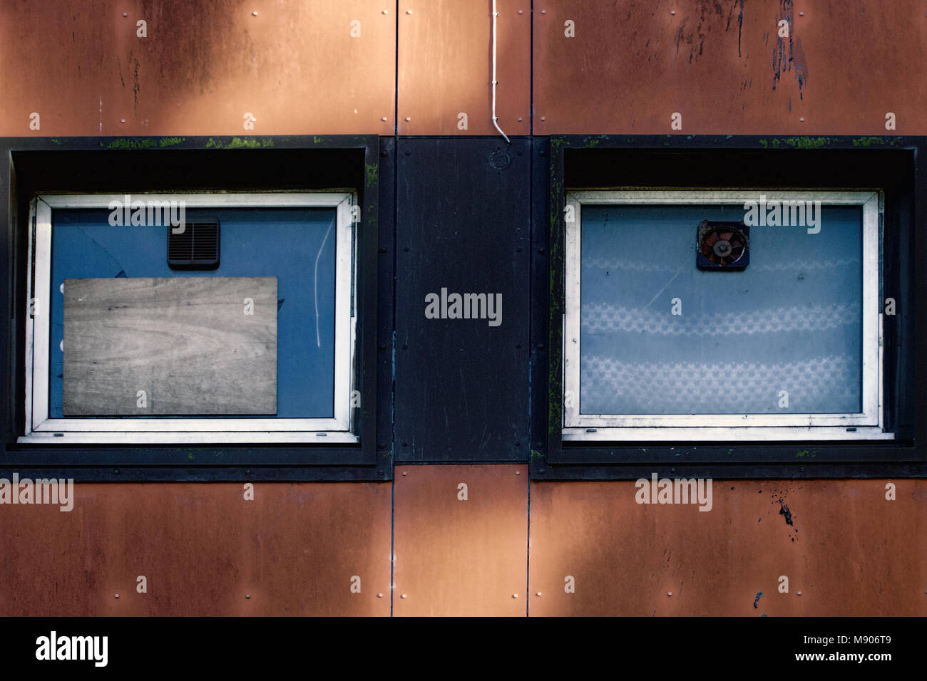 Windows on mainly empty, dilapidated housing in a deprived area, depicting poverty, Yoker, Glasgow, Scotland (March Stock Photo