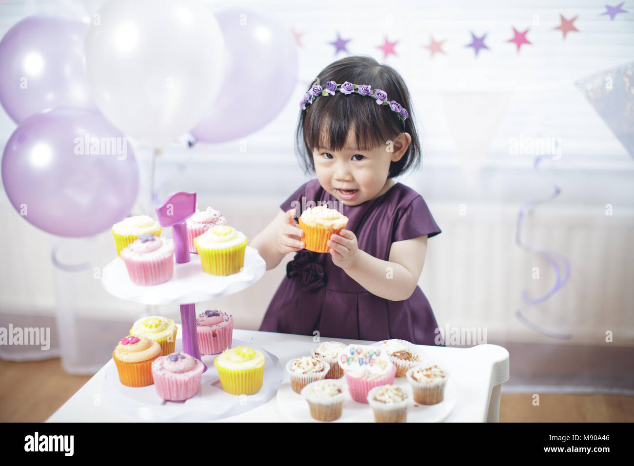Baby girl celebrate her second birthday - Stock Image