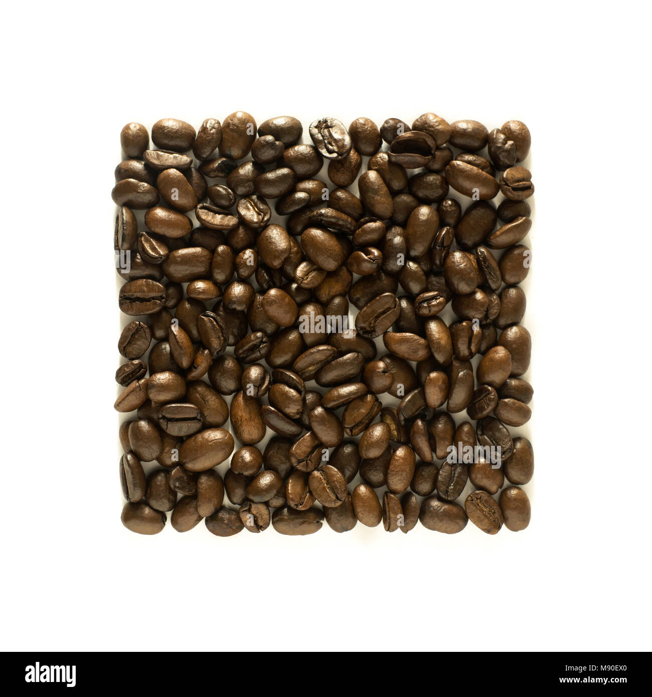 Neat square arrangement of coffee beans - isolated on white - Stock Image