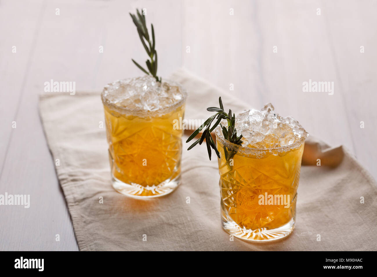 Chilled drink with a branch and ice - Stock Image