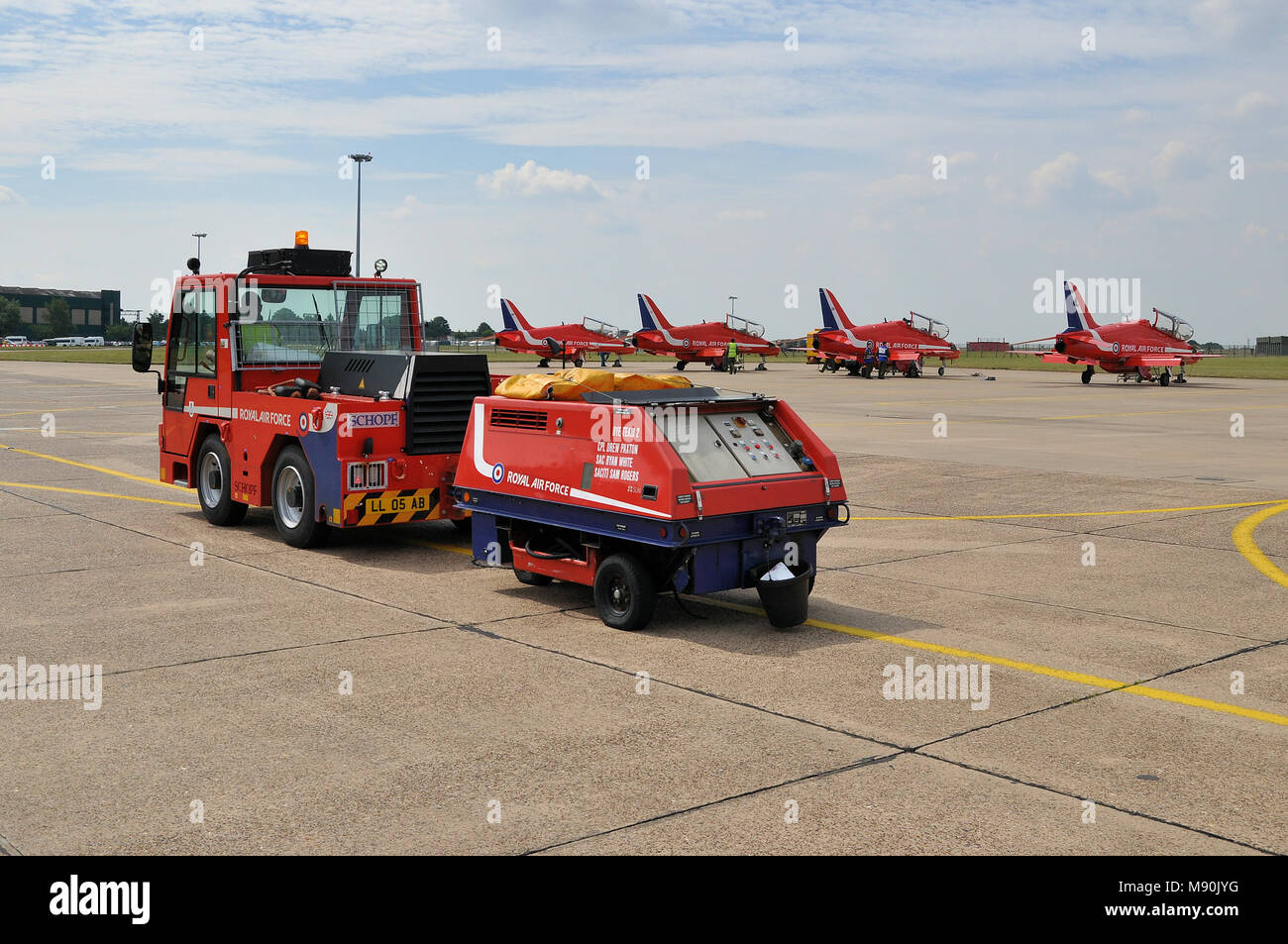 Dye Team tug and smoke dye servicing unit of the Royal Air Force Red Arrows at RAF Scampton. Engineers. Mechanics. Servicing team. Jet planes - Stock Image