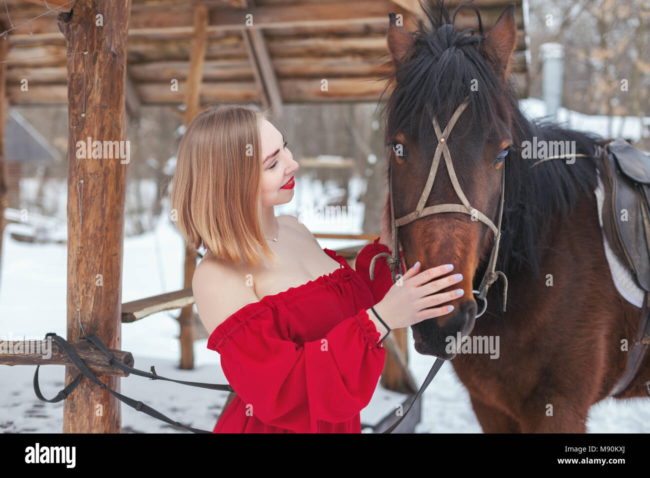 Beautiful Young Woman Standing Near The Stables With Horse Stock Photo Alamy