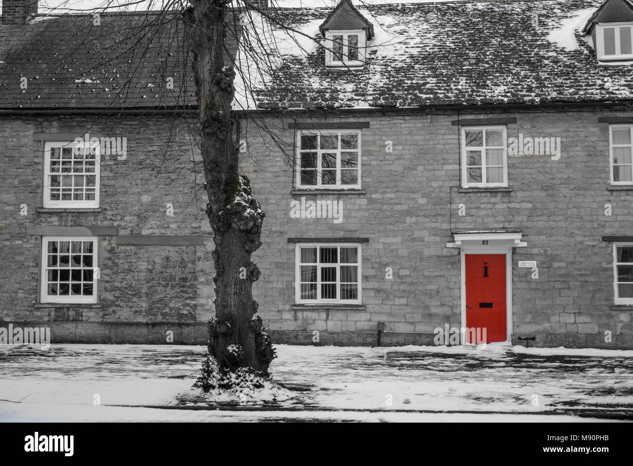 House with red door on Corn Street, Witney, Oxfordshire - Stock Image