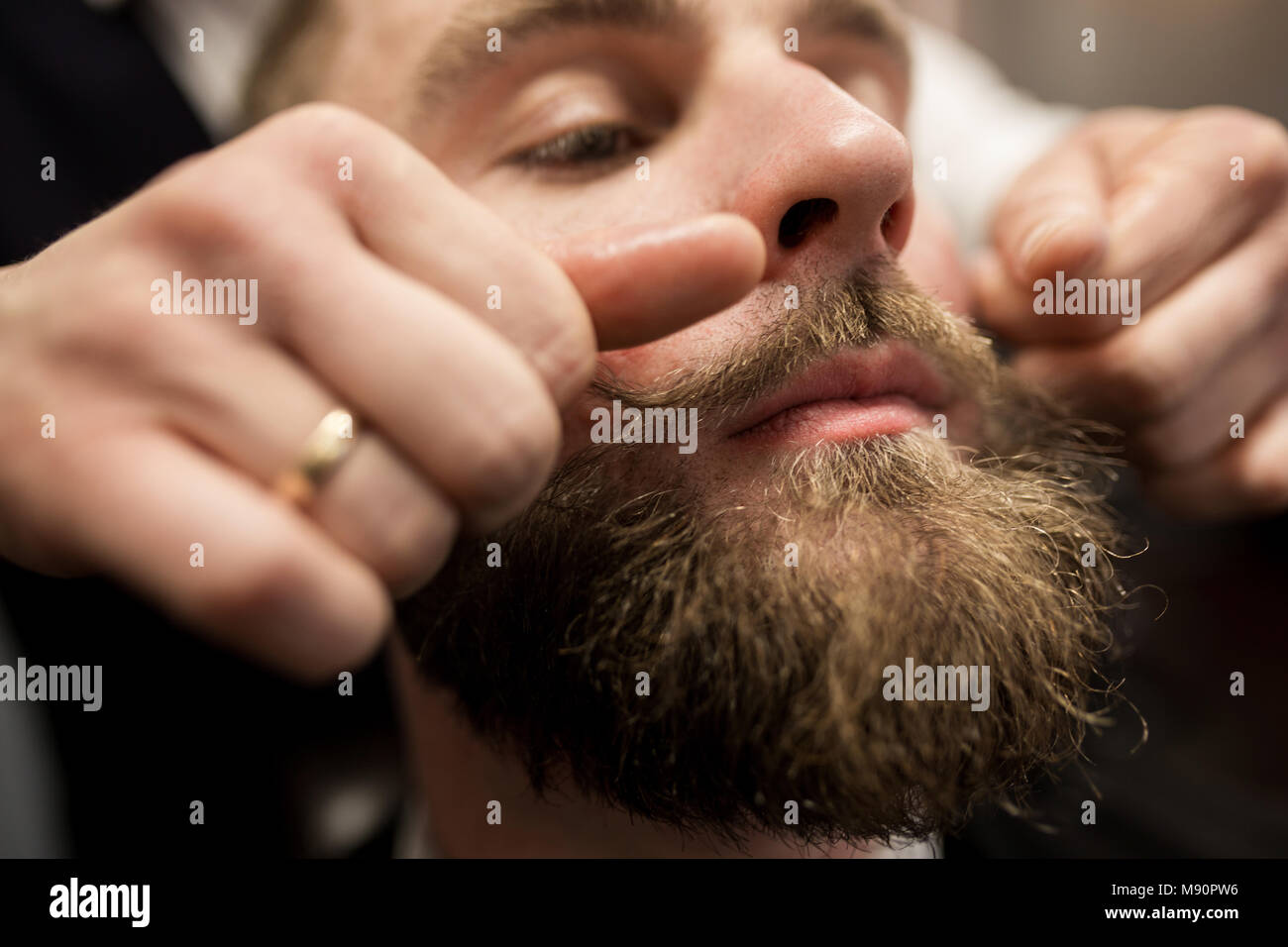Close up portrait of bearded man having mustache curling up - Stock Image