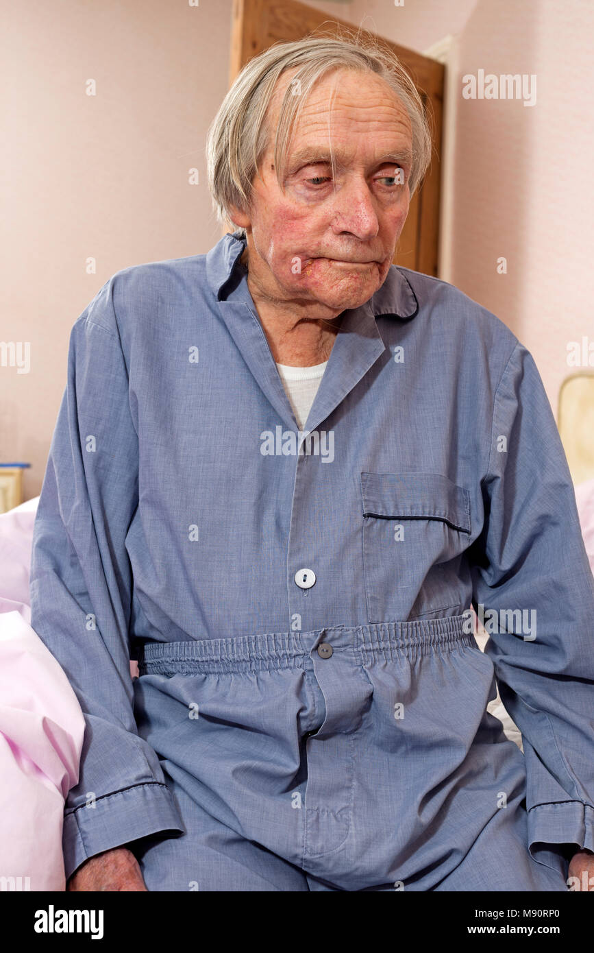 91-year old man getting ready for bed Stock Photo