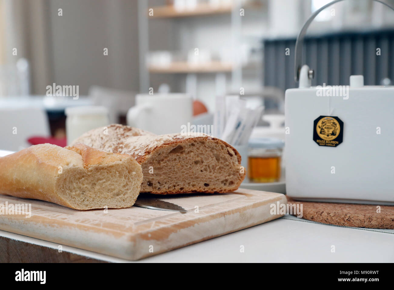 Breakfast on a table at a hotel. Bred and tea. - Stock Image