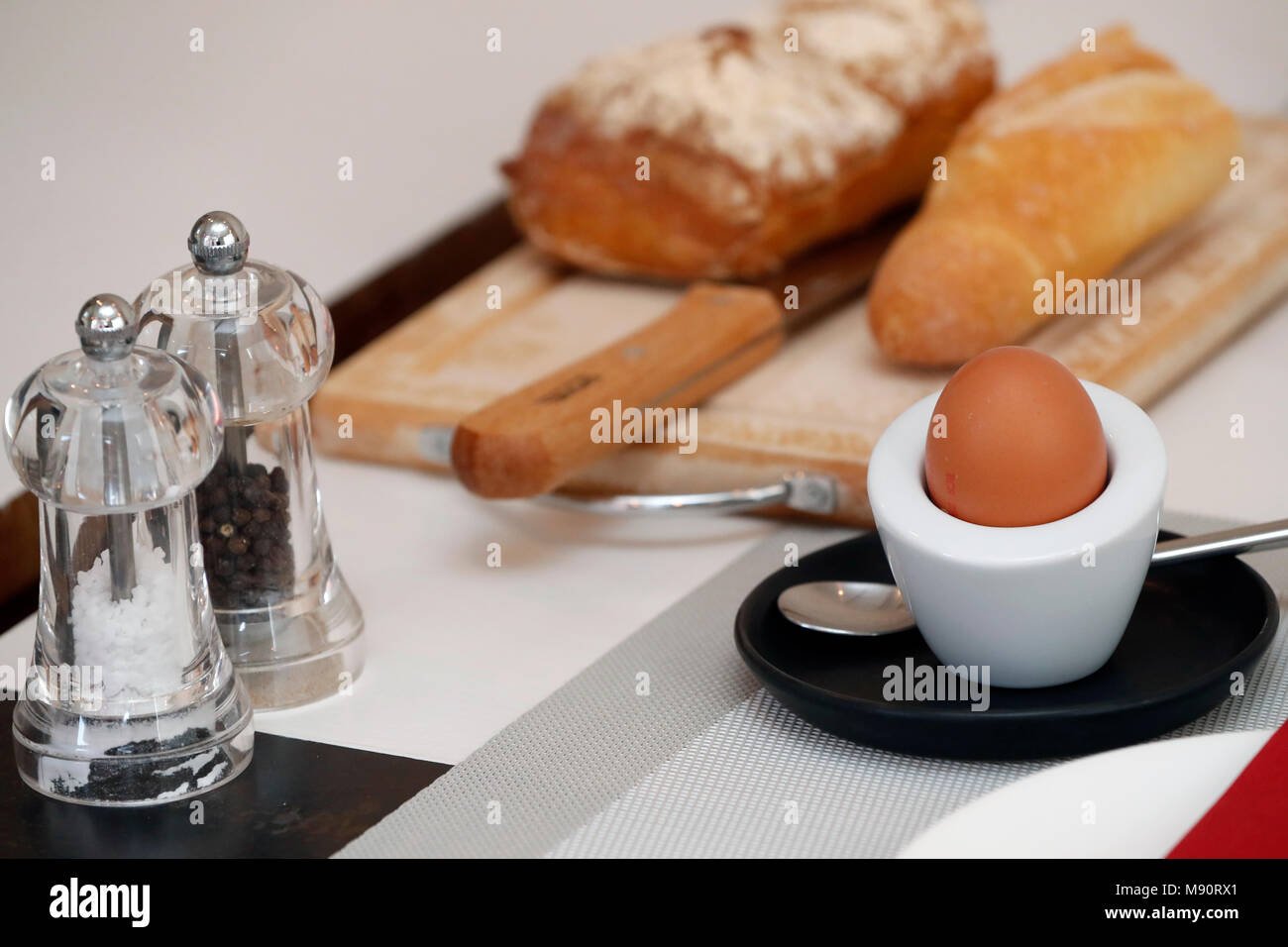 Breakfast on a table at a hotel. Egg and bred. - Stock Image