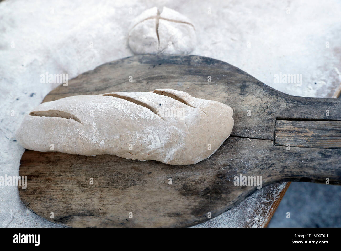 The agriculture fair (Comice Agricole) of Saint-Gervais-les-Bains. Baker making artisan bread. - Stock Image