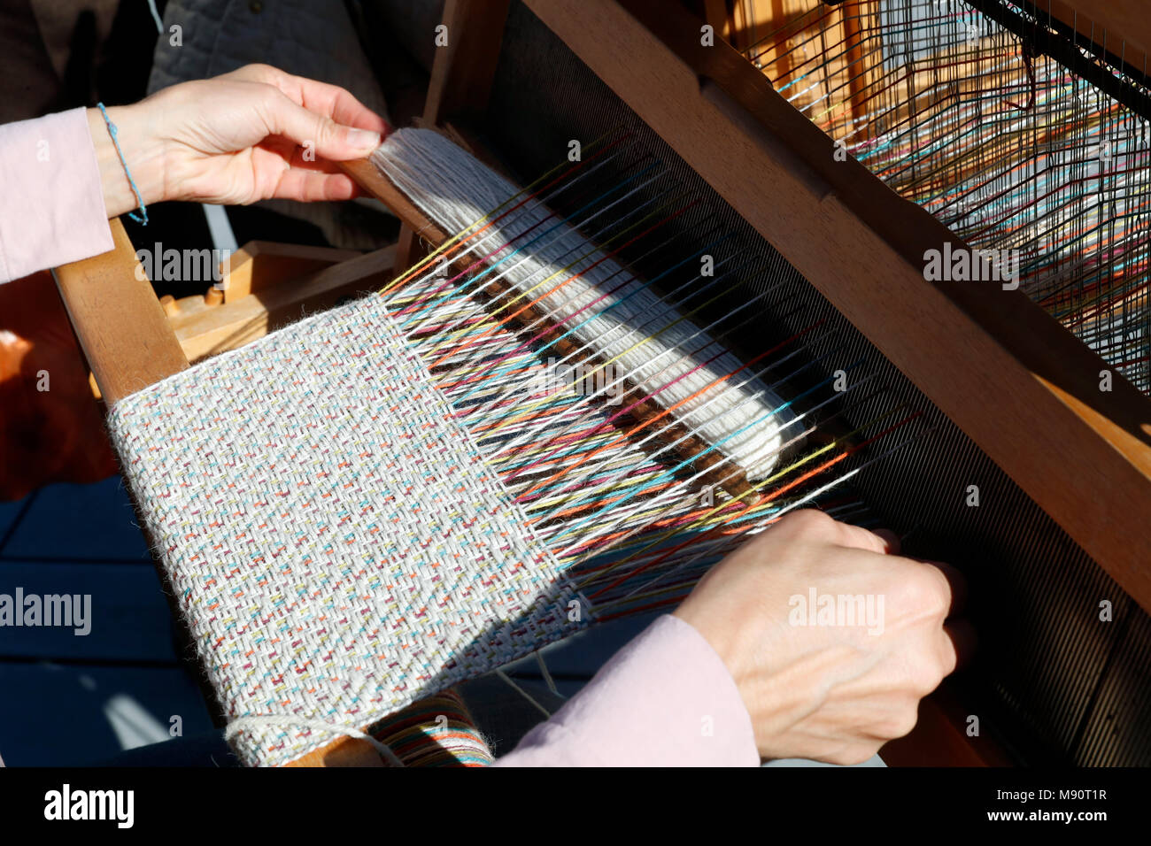 Close-up of weaving loom. - Stock Image
