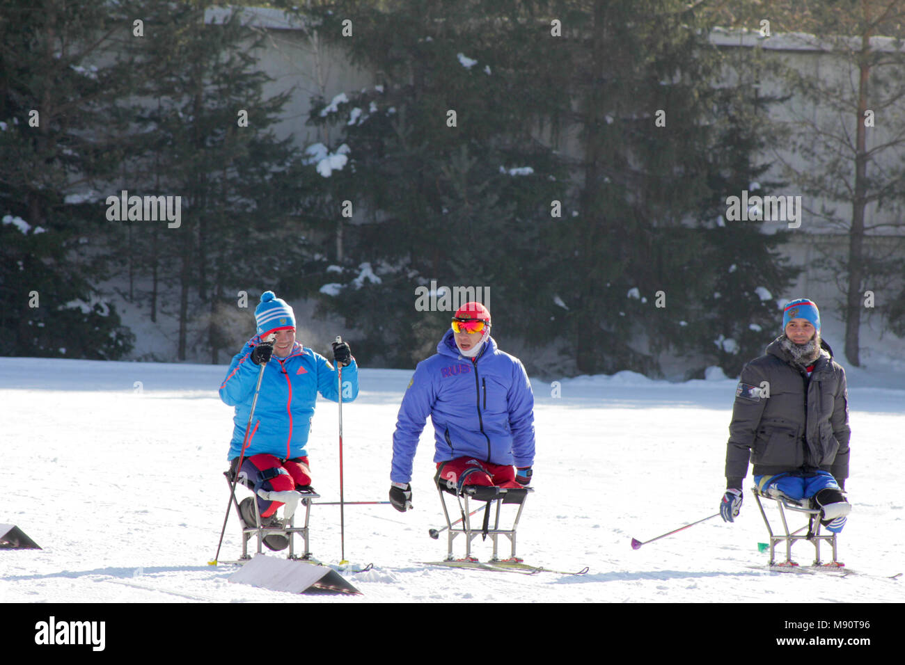 KAZAN, RUSSIA - MARCH, 2018: Three disabled skiers waiting to start on city ski competitions - Stock Image