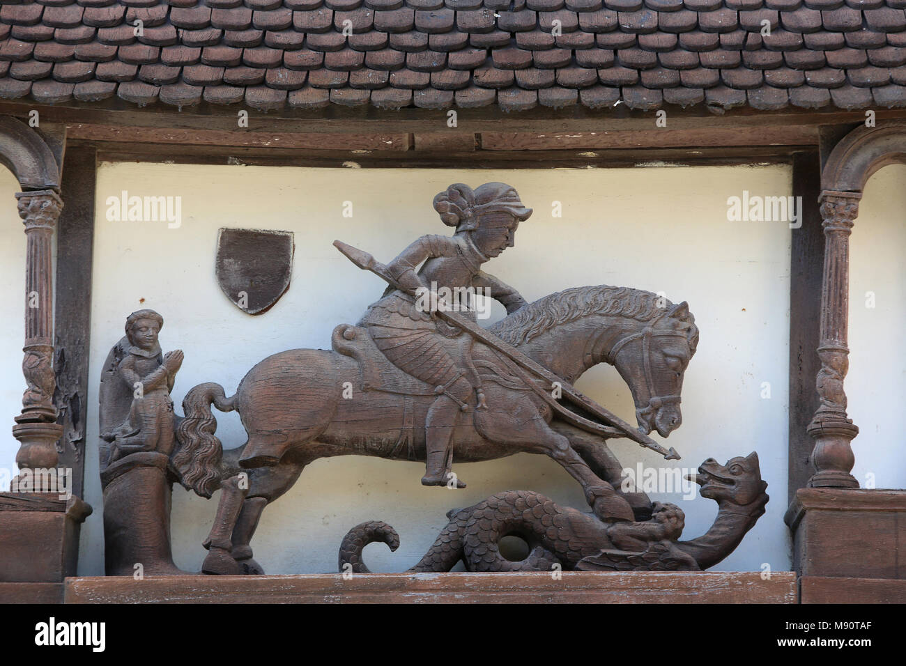 Arts and craft village in Dives sur Mer, France. Architectural detail. St George slaying the dragon. - Stock Image